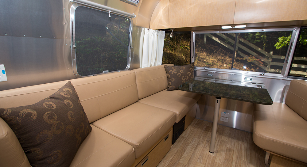 Classic Windstream tan panels and seat covers and black-top table.