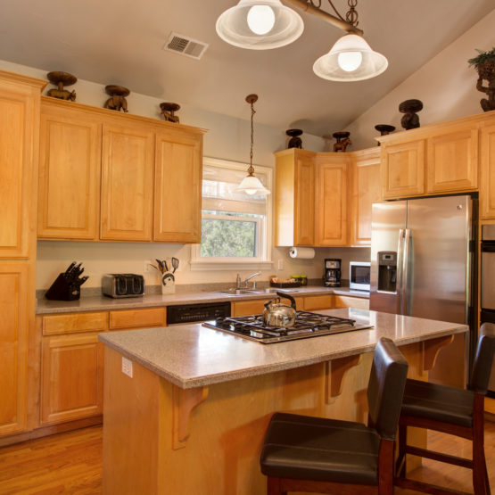 Open kitchen, gas stove stove, island, ample light and cabinetry